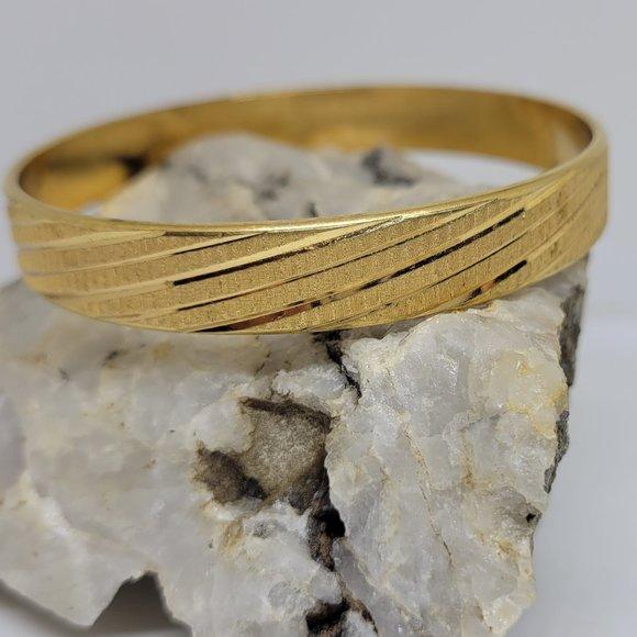 Monet stunning gold tone bangle bracelet